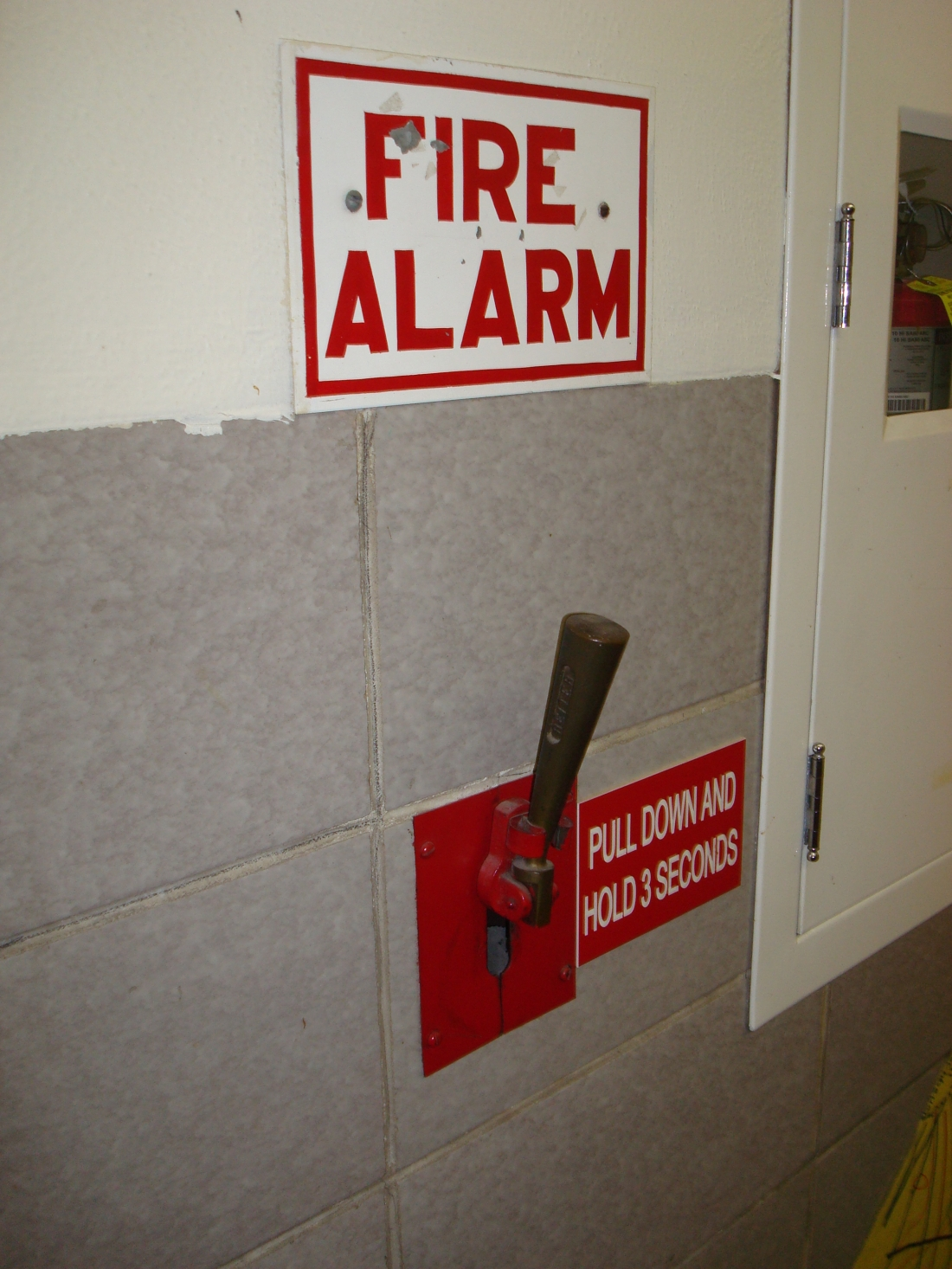 Reiter Company Pull Rod Fire Alarm. The pull rod is concealed within the wall and controlled by the brass pull handle.